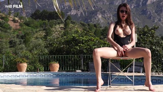 Gorgeous Mila Azul wanks her soaking wet pussy by the pool