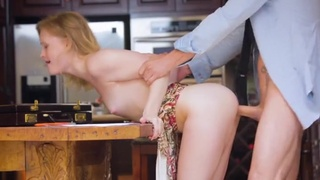Pretty slut bent over a table and banged from behind