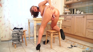 Sex-crazy aged housewife Marta is playing with her worn out pussy
