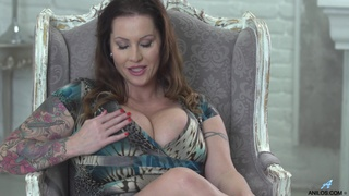 Laura Orsolya reaches an orgasm on the sofa fingering herself