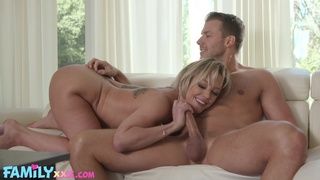 Fake boobs MILF Dee Williams spreads her legs to ride a large dick