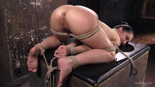 Tied up whore seems ready for her anal punishment