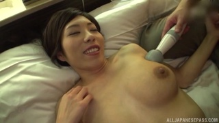 Busty Asian beauty stimulated with toys before sex