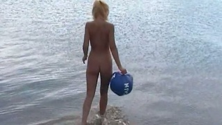 I love watching these blondes play with the ball on the nude beach