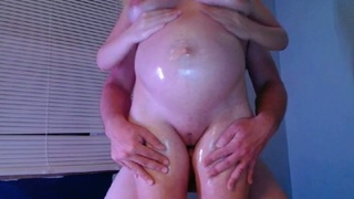 This pregnant woman's arousal is evident and she gives some nice thigh job