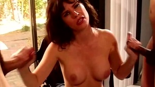 MILF Strokes Off Two Cocks