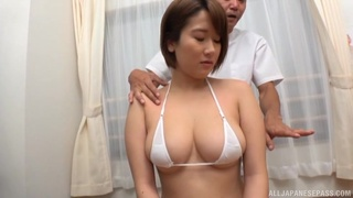 Busty Asian chick massages a delicious cock with her mouth