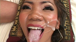 Doting sex doll takes a facial cumshot from a big cock after a hardcore fuck