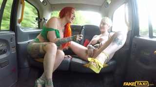 Naked girls share the dick in the back of the cab
