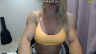 Muscle girl shows veiny arms