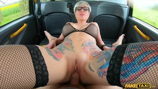 Tattooed blonde gets ass fucked in the fake taxi backseat