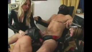 Dominant blonde forces two masked studs fuck each other