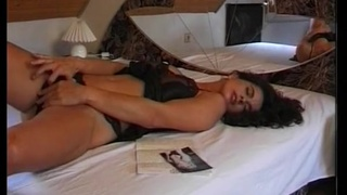 Excited brunette performs a passionate solo action in bed