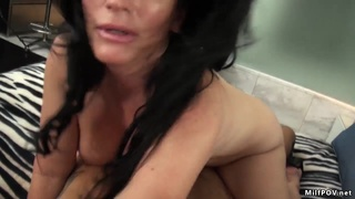 Big butt cougar riding cameraman's cock in her first porn scene