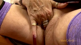 Suede boots look sexy on an old lady as she masturbates
